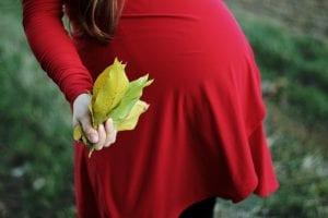 Gravid och värk i rygg och axlar.